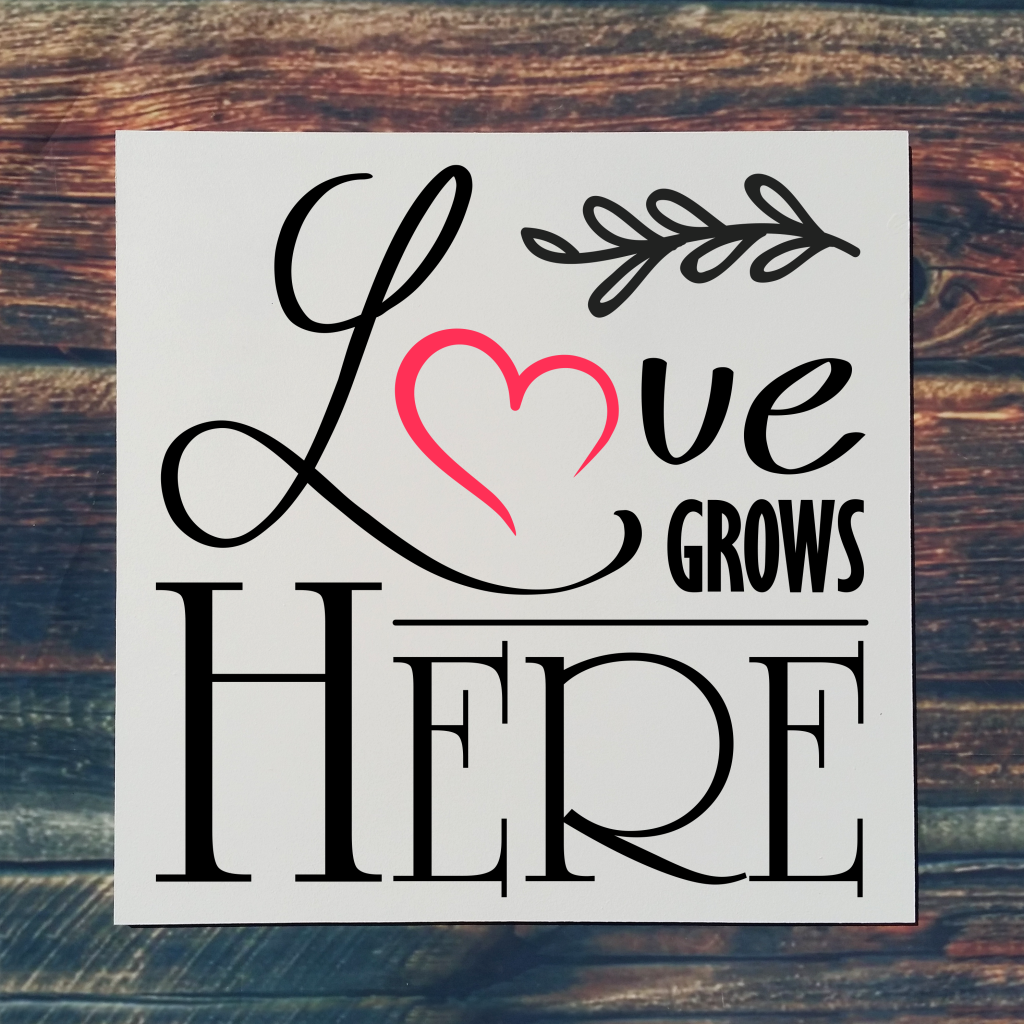 """""""Love grows here"""" with heart on 16x16 board"""